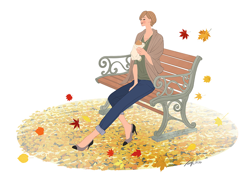The woman who sits on the autumn bench in colored leaves, and eats croissant.